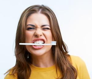 biting a toothbrush