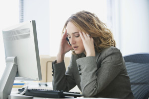 woman stressed at her computer