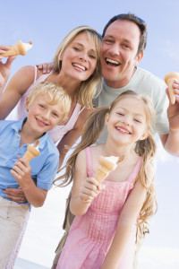 family enjoying ice cream in summer