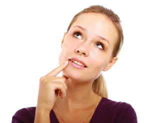 blonde woman pondering